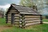 Cabaña de troncos, uno de los sistemas de construcción de viviendas en madera más antiguos.